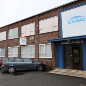 Freehold office building & light industrial unit with generous parking.
