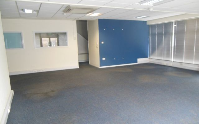 Retail showroom & office premises with 8 parking spaces.