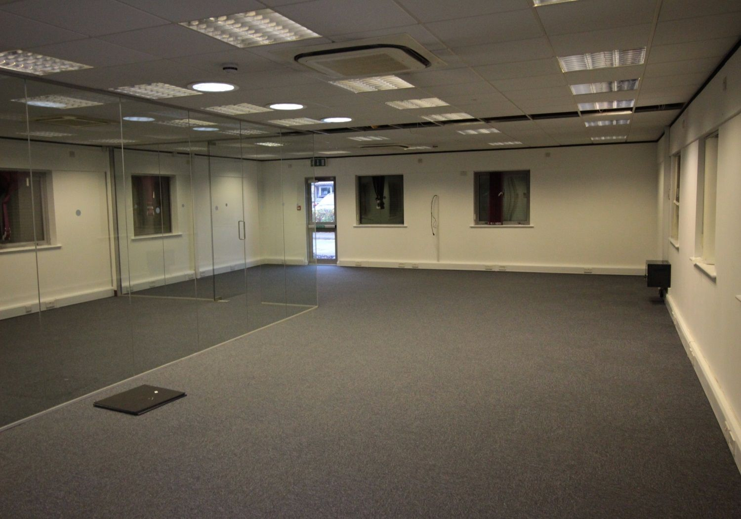 Refurbished modern office building with 6 parking spaces.