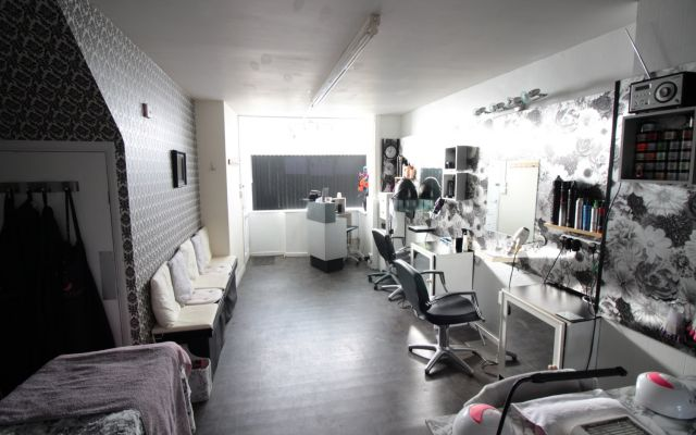 Freehold commercial investment building comprising  ground floor hair salon & first floor self-contained flat.