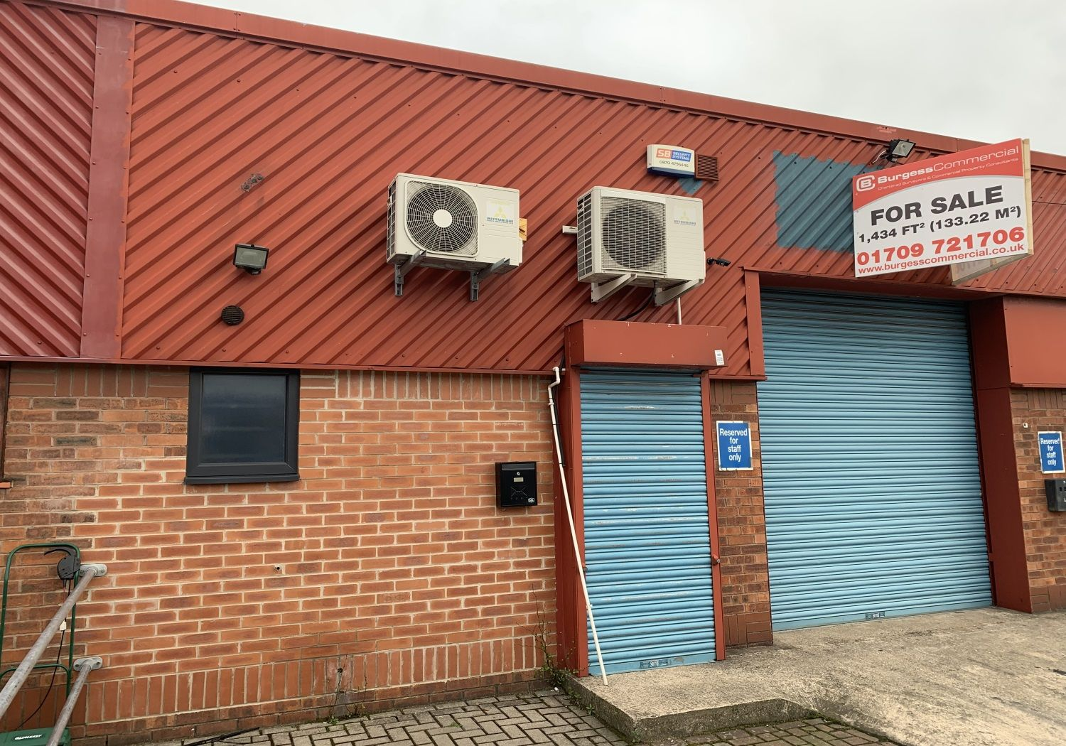 Modern industrial unit for sale with solar panels.