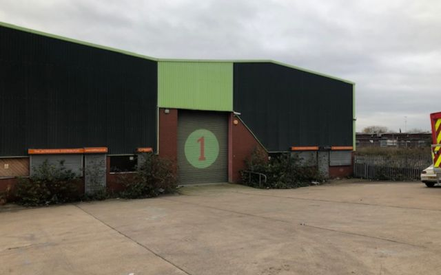 Warehouse premises with large car park & yard.
