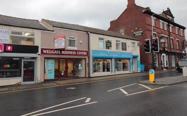 Freehold offices & separate retail unit for sale.